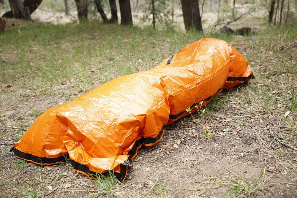 best bivy sack, man in bivy sack outside, best bivy sack for camping, best ultralight bivy sack
