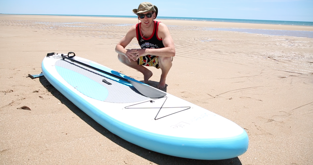 man with stand up paddleboard