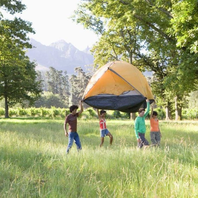 4-people-holding-tent