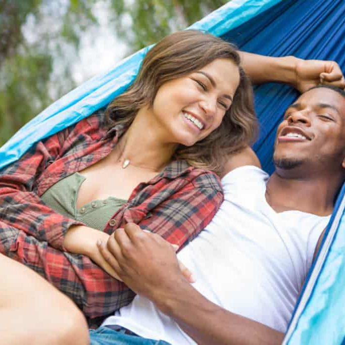 backpacking couple in Camping hammock